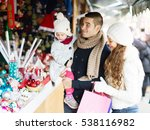 Happy Family Choosing Christma...