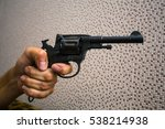 "Small photo of Russian revolver ""Nagant M1895"" (example of 1913) in hand. Period of WWI. Isolated on the white background."