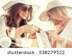 two young women sharing their... | Shutterstock . vector #538279522
