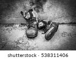 Old Boots On Grunge Background...