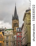 Small photo of AACHEN/ GERMANY - NOVEMBER 20, 2016: Tower of Aachen Cathedral rises above all other buildings in the city center decorated for Christmas