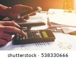 young businessman calculating... | Shutterstock . vector #538330666