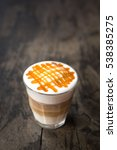 glass of hot caramel macchiato... | Shutterstock . vector #538385275