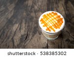 glass of hot caramel macchiato... | Shutterstock . vector #538385302