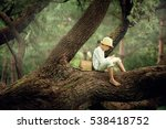 a boy in a straw hat reading a... | Shutterstock . vector #538418752