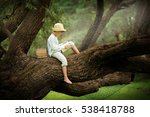 a boy in a straw hat reading a... | Shutterstock . vector #538418788