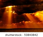 Dark Clouds With Sun Rays Over...
