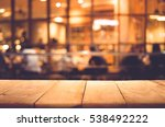 wood table top on blurred of... | Shutterstock . vector #538492222