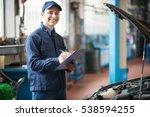 portrait of a mechanic writing... | Shutterstock . vector #538594255