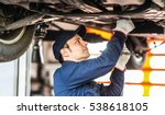 mechanic repairing a car | Shutterstock . vector #538618105