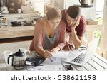 young stressed family paying... | Shutterstock . vector #538621198