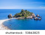 Sea of Sicily; Taormina beach with 'Isola Bella' - stock photo