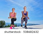 two pretty women stretching in... | Shutterstock . vector #538682632