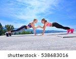 Two Pretty Women Stretching In...
