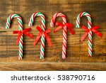 Sweet Candy Canes With Red...