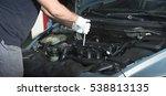 hands of car mechanic with a... | Shutterstock . vector #538813135