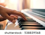 woman's hands playing the piano | Shutterstock . vector #538839568