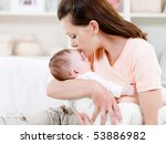 young mother kissing her small... | Shutterstock . vector #53886982