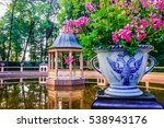 Old Gazebo And A Vase With...