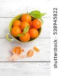 mandarin fruits in bowl on... | Shutterstock . vector #538945822
