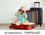 baby sitting in suitcase | Shutterstock . vector #538961602