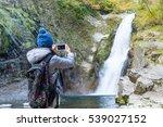 Woman Taking Photo In Akiu...