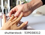 man giving engagement ring to... | Shutterstock . vector #539038312
