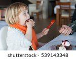 two years old child with orange ... | Shutterstock . vector #539143348