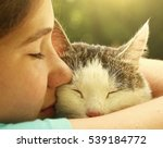Stock photo teen girl hug cat close up portrait on the summer garden background 539184772