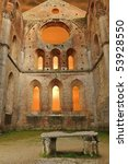 Small photo of Abbazia di San Galgano. Tuscany, Italy. Famous abbacy without roof against dramatic sky.