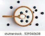 white yogurt in natural wooden... | Shutterstock . vector #539360638