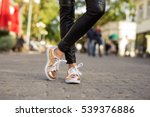 modern woman in shinny sneakers  | Shutterstock . vector #539376886