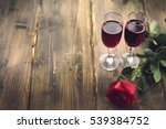 Rose And Two Glasses Of Wine O...