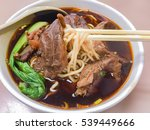 braised beef noodle soup with... | Shutterstock . vector #539449666