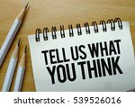 Small photo of Tell Us What You Think text written on a notebook with pencils