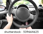 Female Hand And Steering Wheel...