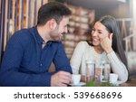 flirting in a cafe. beautiful... | Shutterstock . vector #539668696