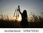 Small photo of Woman holding dream catcher