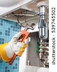 repairing a pipe under sink....   Shutterstock . vector #539745502