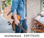 young hipster man playing... | Shutterstock . vector #539770192