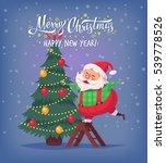 santa claus decorating tree... | Shutterstock . vector #539778526
