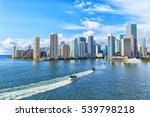 Stock photo aerial view of miami skyscrapers with blue cloudy sky white boat sailing next to miami downtown 539798218