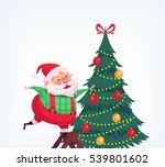 santa claus decorating tree... | Shutterstock . vector #539801602