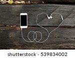 smart phone on the wooden floor ... | Shutterstock . vector #539834002