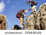 Small photo of Help, support and help in a dangerous situation to hike in the mountains.