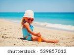 little girl applying sunblock... | Shutterstock . vector #539857012