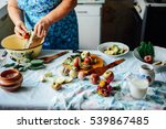the woman is cooking pancakes.... | Shutterstock . vector #539867485