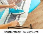 closeup of woman ironing... | Shutterstock . vector #539898895
