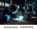 man welds at the factory | Shutterstock . vector #539932906