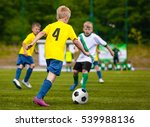 boys kicking soccer ball.... | Shutterstock . vector #539988136